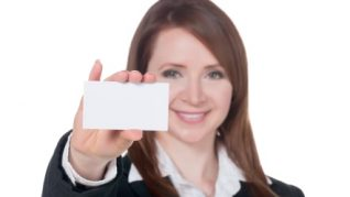 a smiling businesswoman holding empty card