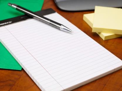 close up shot of notepad and pen